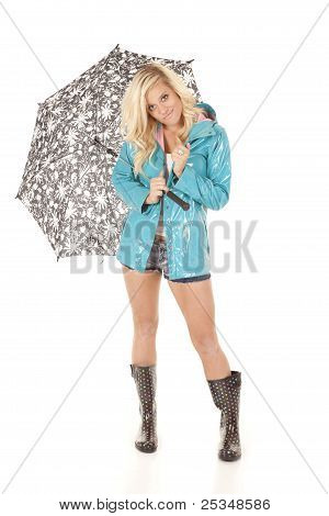 Woman In Slicker With Umbrella And Boots