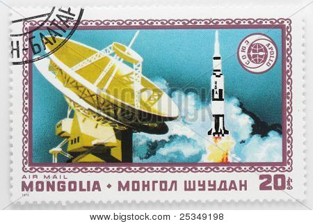 MONGOLIA - CIRCA 1976: A stamp printed in Mongolia shows launching rocket Saturn 1B with spaceship Apollo ASTP Apolloâ??Soyuz Test Project, circa 1976.
