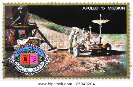 UMM AL-QUWAIN - CIRCA 1975: A stamp printed in Umm al-Quwain shows astronaut David Scott on the moon with LRV Rover from spaceship Apollo 15, circa 1975.