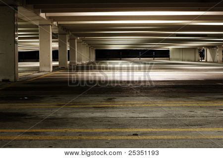 Empty parking garage at night, dirty and dark.