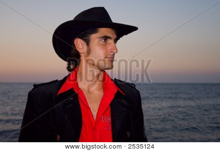 Sunset. Handsome Man Is On A Beach.