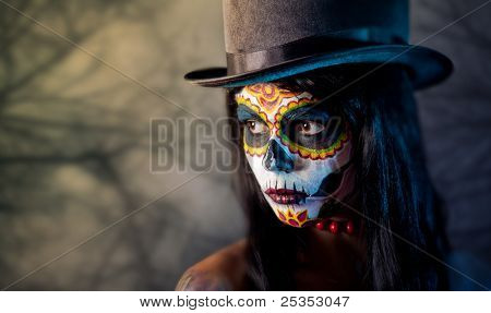 Sugar skull girl in tophat, in the forest