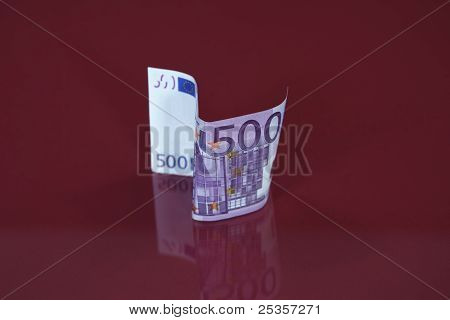 500 euro bill reflects in glass