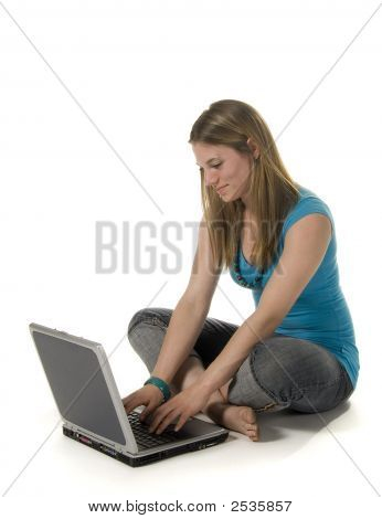 Teenage Girl Using Laptop Computer