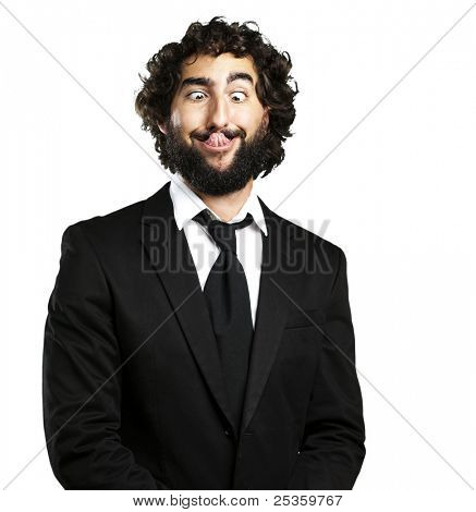 portrait of young business man showing the tongue over white background