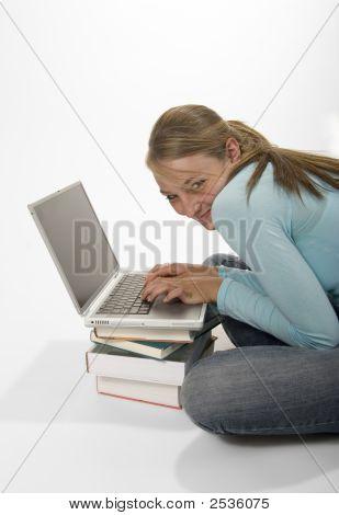 Mischievous Girl On Laptop
