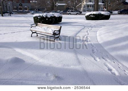 Empty Snowy Bench