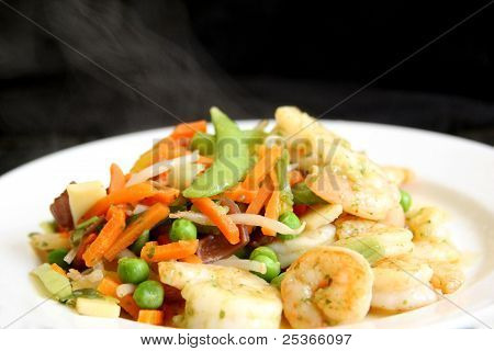 steaming hot dish of vegetables and shrimps