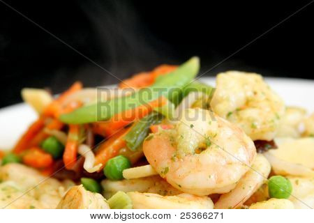 steaming healthy food: vegetables and prawns