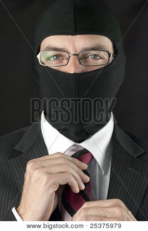 Businessman In Balaclava Adjusts Tie