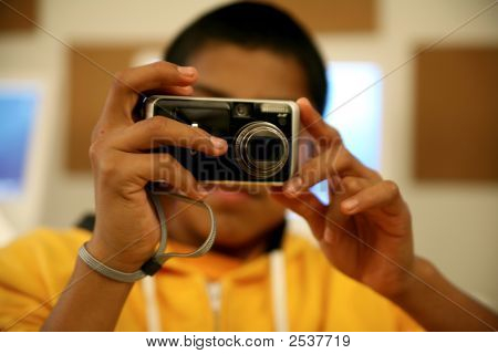 Young Photographer With Digital Camera