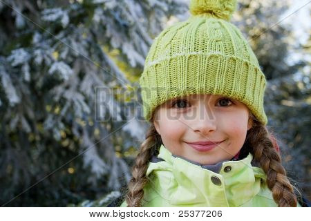 Portrait of little girl in winter forest