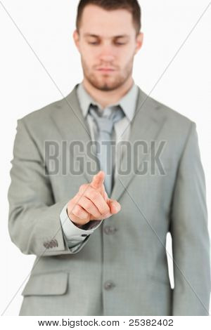 Businessman using futuristic touchscreen against a white background