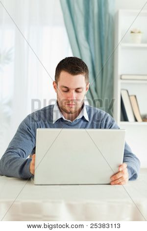 Young man with his laptop in his homeoffice