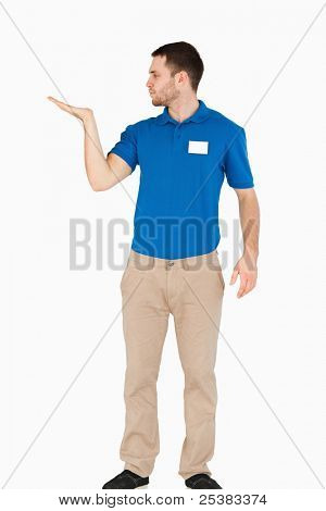 Young salesman presenting in his palm against a white background