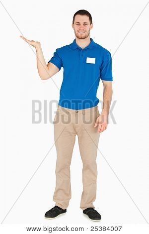 Smiling young salesman presenting in his palm against a white background