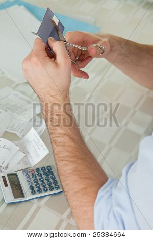 Credit card being destroyed by scissor