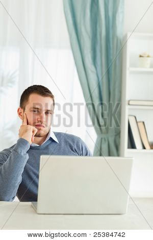 Young businessman bored in his homeoffice