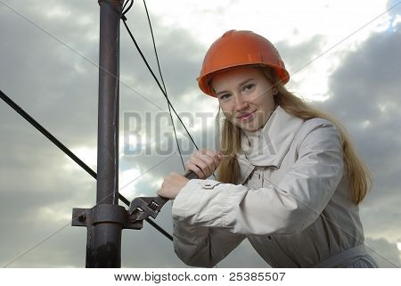 Smiling female with a wrench