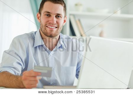 Young businessman with notebook and credit card