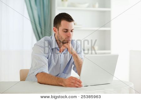 Young businessman reading an e-mail