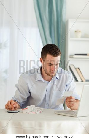 Young businessman doing his calculations