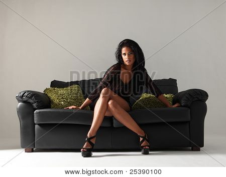 Sexy Fashion Model Long Legs In Heels On Couch