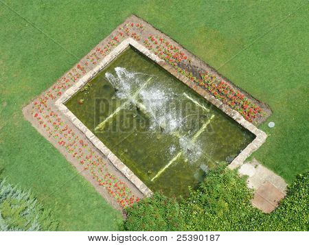 Fountain In A Pond