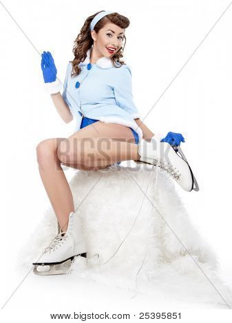beautiful young pin-up woman going to ice skating