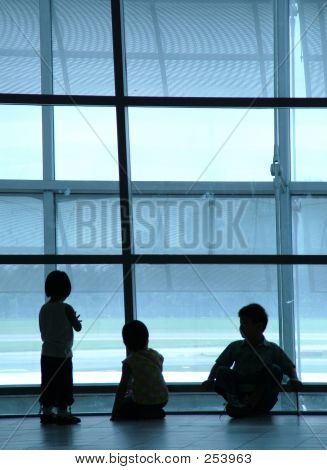 Silhouette Of Kids At Airport