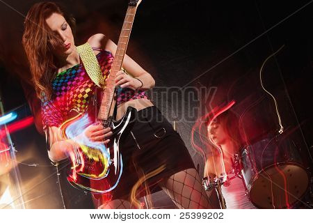 Female Band Playing On Stage