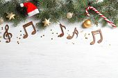 Flat Lay Composition With Decorations And  Notes On Wooden Background. Christmas Music Concept poster