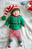 Cute Baby In Christmas Costume Lying On Blanket poster