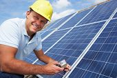picture of harness  - Man installing solar panels - JPG