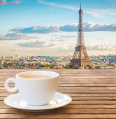 Cup Of Coffee With View Of Famous Eiffel Tower Landmark And Paris Old Roofs, Paris France, Toned poster