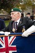 British Legion glags are rolled away by Ex-servicemen