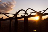 A Barbed Wire Contrasted On A Dusk Sun Light Background poster