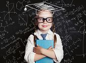 Successful Female Career Concept. Cheerful Little Girl Math Student In Graduation Hat On School Blac poster