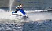 picture of jet-ski  - action photo of young woman on seadoo at high speed - JPG