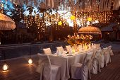 Wedding Banquet Or Gala Dinner Decorated With Garlands. Festive Table Set Up Decor For Wedding, Part poster