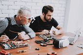 Two Men Repairing Hardware Equipment From Pc. Repair Shop. Worker With Tools. Computer Hardware. You poster