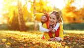Happy Family Mother And Child Daughter Playing And Laughing On   Autumn Walk poster