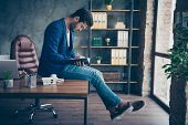 Attractive Handsome Young Brunet Bearded Serious Executive Worker Man In Office Workstation Workplac poster
