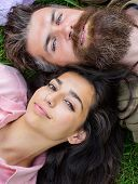 Hipster Bearded Man And Girl Happy Carefree Enjoy Relax. Man Unshaven And Girl Lay Near Top View. Fe poster