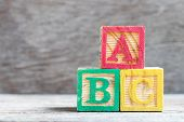 Color Letter Block In Word Abc On Wood Background poster