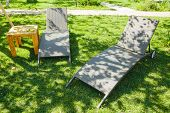 Two Deckchairs On The Green Grass In The Garden On A Summer Sunny Day In The Shade. View From Above. poster