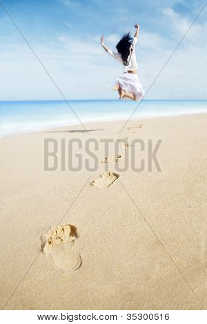 Woman With Footprint Enjoying Freedom On Beach