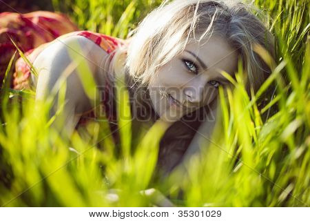 Beautiful Girl Lies In A Green Grass