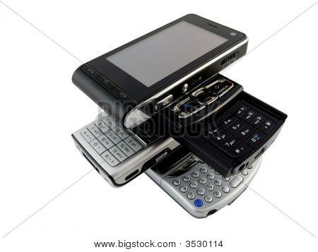 Stack Of Several Modern Mobile Phones On White