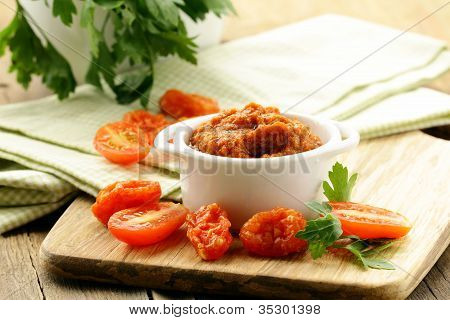 Red pesto sun-dried tomatoes in a white bowl